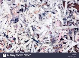 paper cut into tiny pieces by cross shredder stock photo royalty