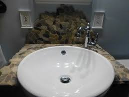 amazing brown pebble stone bathroom sink backsplash ideas for grey wall jpg