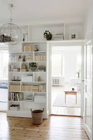 Small Bookshelf With Doors Tiny House Decorating Inspiration White Built In Shelving And