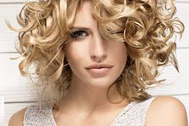 medium length layered hairstyles for curly hair curly hair layered haircuts women medium haircut