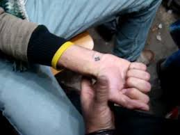 coptic cross tatoo in