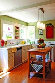 kitchen style green painted wall cabinets beige ceramic floors