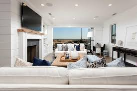 oceanfront living room with folding glass patio doors cottage