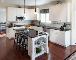 white kitchen cabinets with black island what countertop color looks best with white cabinets