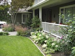 front yard ranch style house with hydrangeas outdoor landscaping