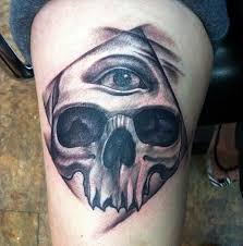 black and grey skull and all seeing eye tattoo by red at certified
