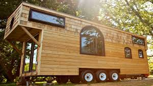 tiny house on wheels vintage high ceiling geometric windows