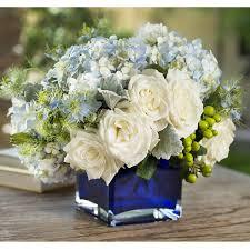 white and blue roses vase