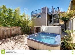 small wooden walkout deck with tub house exterior stock