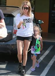 ashley tisdale displays toned legs in tiny black shorts at nail