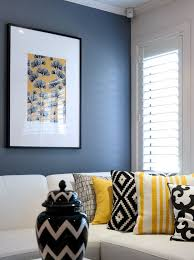 take a look at this black yellow and white living room from the