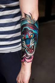 colorful blue tiger on arm think tiger
