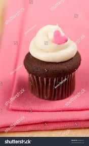 cute chocolate cupcake vanilla frosting tiny stock photo 64044121