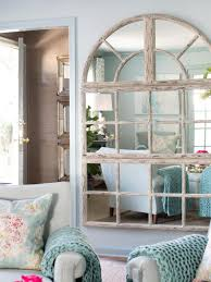 cottage living room with blue walls and arched wall large mirror