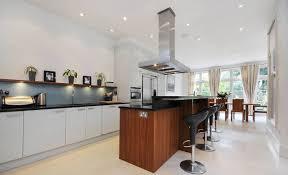 White Kitchen Cabinets Black Countertops by Kitchen Black Bar Stool White Pendant Light White Corner