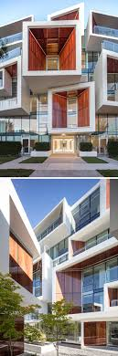 residential architecture design this new building features wood that s been framed inside glass