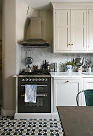 kitchen white classic stained wooden cabinet with stove also full size of kitchen appealing hoods kitchen design with beige paint cabinet also white marble wall