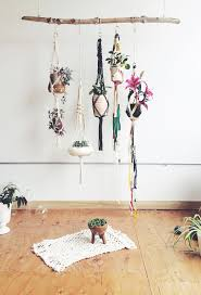 hanging planters with wooden rod hanged on ceiling over brown