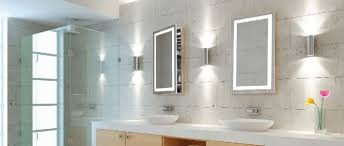 modern bathroom with corner shower stall and lighted medicine