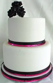 two tier fondant wedding cake with black sugar roses and black and