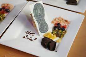 a chocolate shoe sole decorated the dessert of lemon blueberry