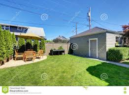 nice green shed in the backyard of american craftsman house stock