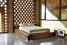 bedroom brown wooden floor low lying bed chandelier exposed