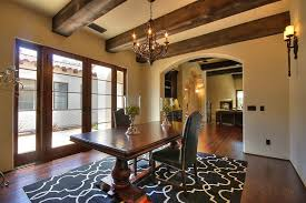 Mediterranean Dining Room With Hardwood Floors By Jay Andre - Wall sconces for dining room