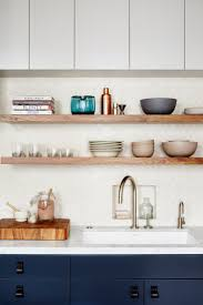 no pulls on upper cabinets exposed shelving backsplash