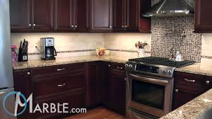 giallo fiorito granite with oak cabinets giallo ornamental granite kitchen countertops iii by marble com