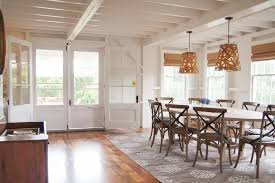cowhide rug under dining table dining room beach style with white
