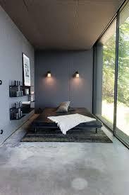 468 best bedroom design tips images on pinterest bedroom dark gray concrete floor to ceiling windows floating shelves sconces low