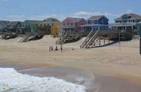 colorful homes line the beach in kill devil hills vacation