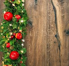colorful christmas decoration red green gold on wooden background