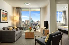 Small Leather Sofas For Small Rooms by Dazzling Small Apartment Living Room With White Standing Lamp And