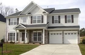 color scheme light gray siding white garage doors and trim gray