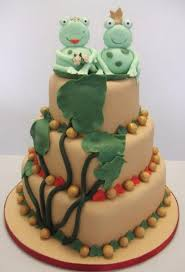 peach color three tier wedding cake with frog bride and groom