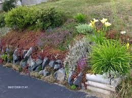 Rock Gardens On Slopes Retaining Wall Rock Garden Gardening Pinterest