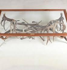 custom made glass top and deer antler coffee table ebth