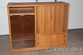 glimmer and grit old entertainment center turned costume closet