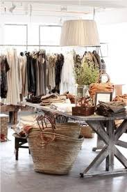 display tables for boutique i like the table floors and how the clothing is displayed on the