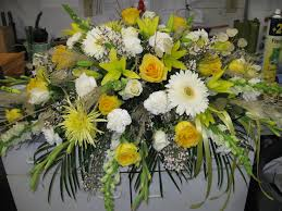0001 casket spray in yellows and whites with roses gerbera