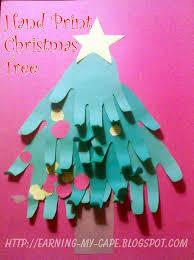 earning my cape hand print christmas tree