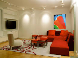 contemporary living room decorated with orange sectional sofa and contemporary living room decorated with orange sectional sofa and illuminated track lighting fixtures