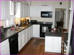 White Cabinets Dark Grey Countertops Black Kitchen Appliances With Oak Cabinets Outofhome
