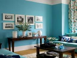 living room modern with blue wall color and arch floor lamps