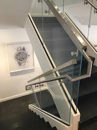 Stairs With Landing by Commercial Staircase With Glass Railings In Miami Design District