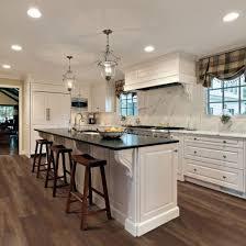 white kitchen cabinets with vinyl plank flooring laminate lvt vinyl a breakdown of engineered floor options