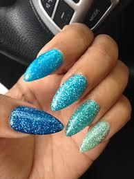 different shades of blue glitter stiletto nails sharp
