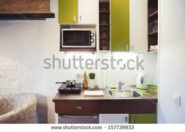 Small Kitchenette by Small Kitchen Appliances Stock Images Royalty Free Images